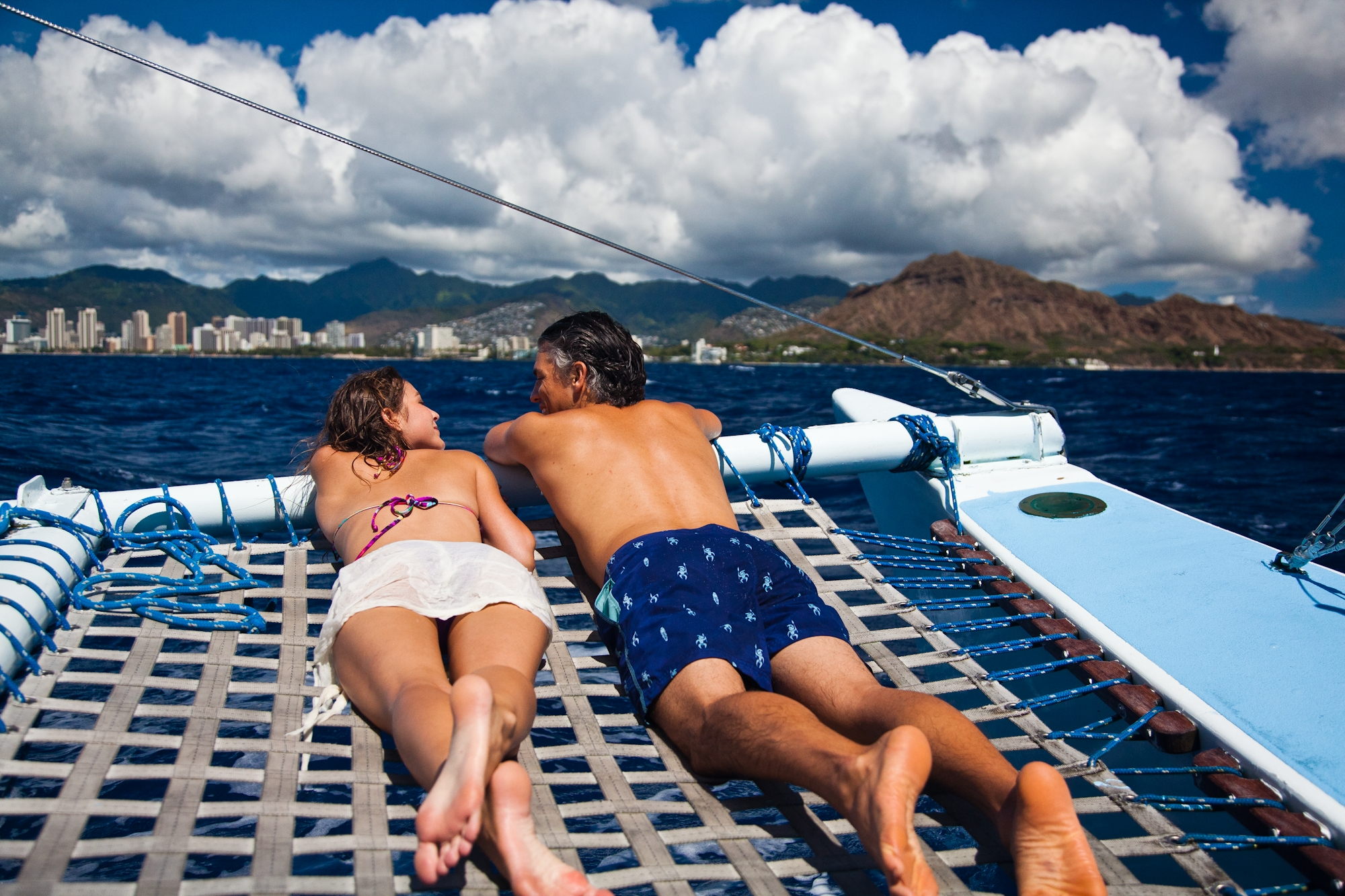 Hawaii-Tourism-Sunbaking-Catamaran